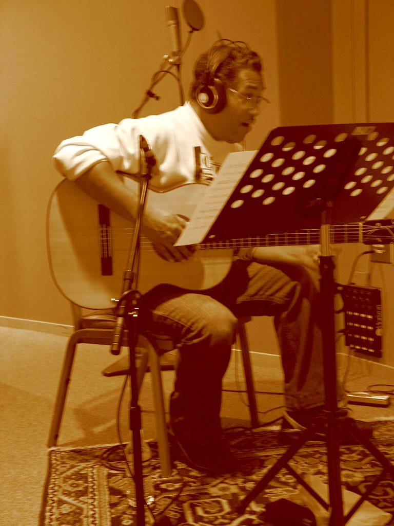 """Daniel """"Zoot Suit"""" Valdez records guitar on """"Only The Dream"""". Photo by Paris Lahman."""