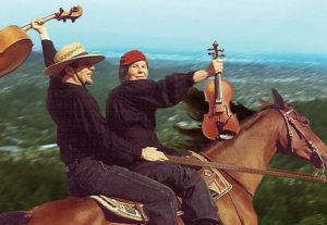 Tim and Frances brandish strings on spirited horse, Tombstone