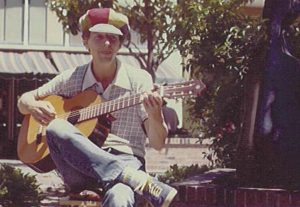 Tim Tompkins plays guitar and sings at Santa Cruz mall, 1980