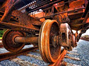 Rusty train wheels on rusty rails. Photo by Gabriel Tompkins.