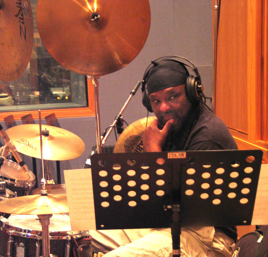 Babatunde Lea, friend and rhythm virtuoso, tuned-in to a studio playback. Photo by Paris Lahman.