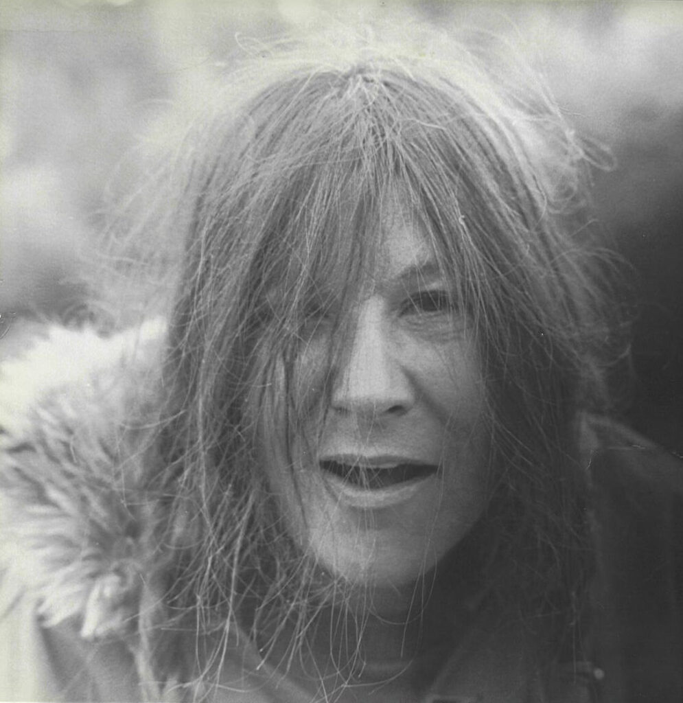 Frances-cavewoman-hair-and-coat